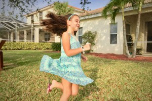 Girl twirling in blue floral dress - This Frugal Mom's Favorite Subscription Box