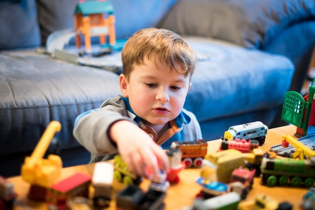 Child playing with toys - Giant List Of Family Activities For A No-Spend Weekend
