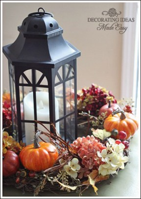 A wreath, mini harvest pieces, and flowers surround a candle. Directions and image courtesy of http://www.decorating-ideas-made-easy.com/thanksgiving-table-decor.html