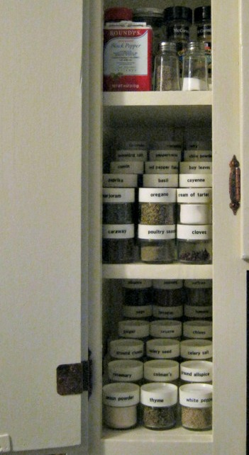"""Spice Cupboard - the """"stair steps"""" are just boards cut to size and stacked."""