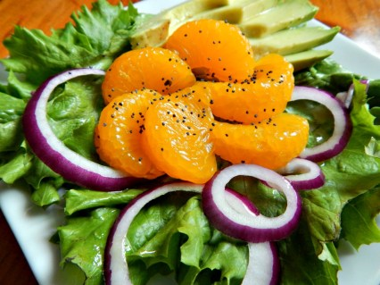 Honey Citrus Vinaigrette on an Orange, Avocado and Red Onion Salad