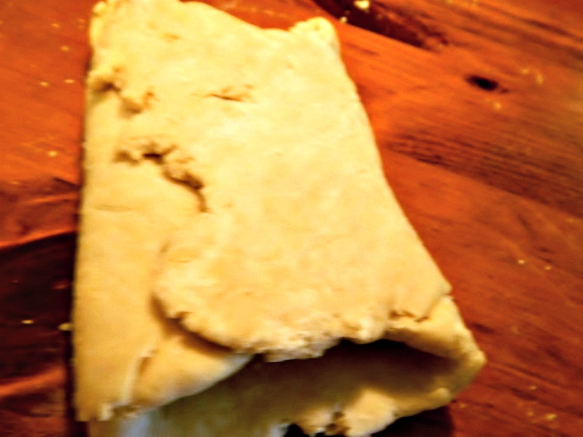 Here's the fold – as you continue the dough will come together. Then refrigerate.