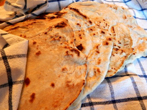 "Super Easy Flat Bread - each a work of art. That's ""code"" for not perfectly round!"