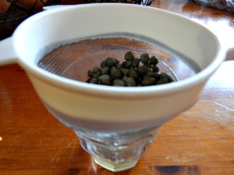 Drain things like olives, capers, etc. over something to catch the liquid, then use the liquid to store what you don't use.
