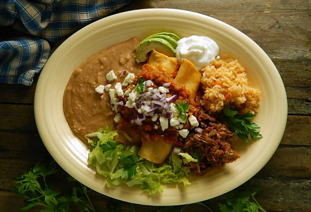 Three Cheese Enchiladas with Braised Pork & Ranchero Sauce