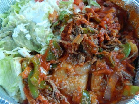 Restaurant Version of Enchiladas Rancheros - it looks SO much better than it tasted.