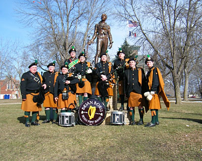 Brian Boru Band in front of the statue of Robert Emmet, courthouse in back. There is a chunk of the Blarney Stone embedded in the base of the statue.