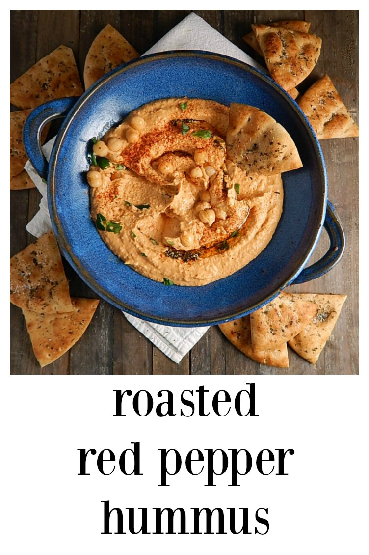 This Roasted Red Pepper Hummus has a bit of spice and a ton of flavor - it's almost addictive and so easy to make at home. #RoastedRedPepperHummus #RedPepperHummus