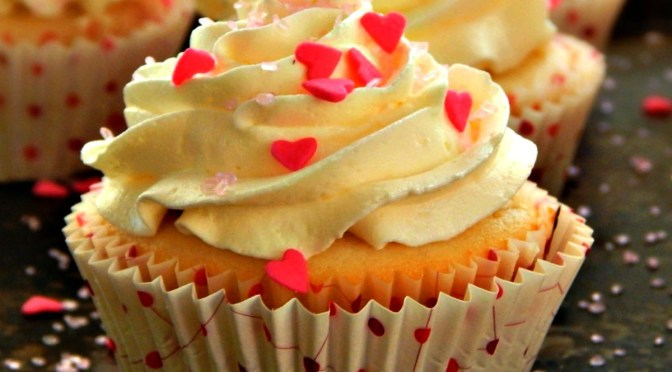 Raspberry Filled Cupcakes with White Chocolate Buttercream