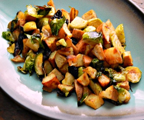 Roasted Sweet Potatoes with Brussels Sprouts, Dried Cherries, and a White Balsamic Honey Vinaigrette.