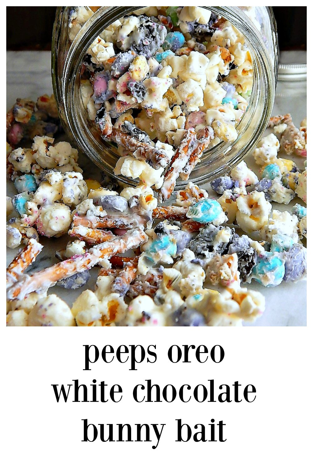 Peeps Oreo White Chocolate Pretzel Bunny Bait Popcorn: an addictive blend of Peeps Oreos, m&m's, pretzels & popcorn all melded together with white chocolate for a delicious treat. Easy to make and perfect for gift bags, adults and children go nuts over this party popcorn. #EasterTreats #EasterPopcorn #BunnyBait