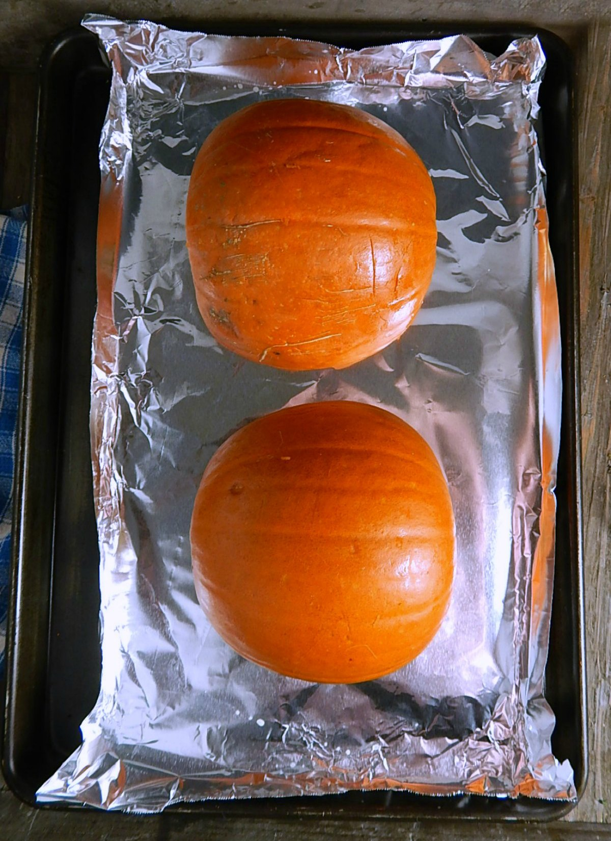 Pumpkins ready to go in oven for Easy Homemade Pumpkin Puree