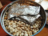 Keep home-made pie shield in with beans.
