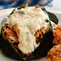 Chipotle Chicken Stuffed Poblanos with Rajas Sauce