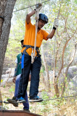 Walking on a single rope with support of hanging ropes are a distance.