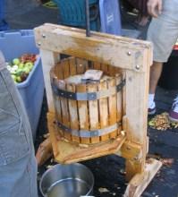 The oak cider press we built in action.