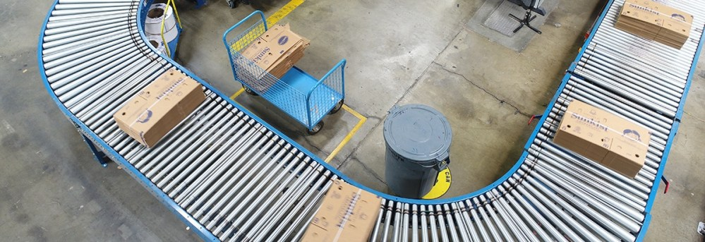 Overhead Photo of Trash Can and Conveyer Belt With Boxes
