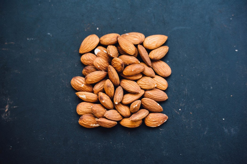 A bunch of almonds on a slate surface