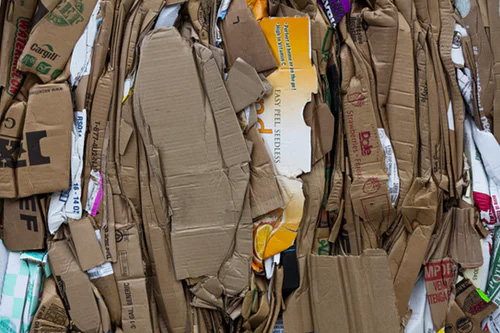 Compressed corrugated cardboard boxes compressed for recycling