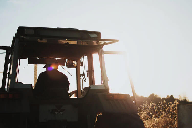 Silhouette man tractor