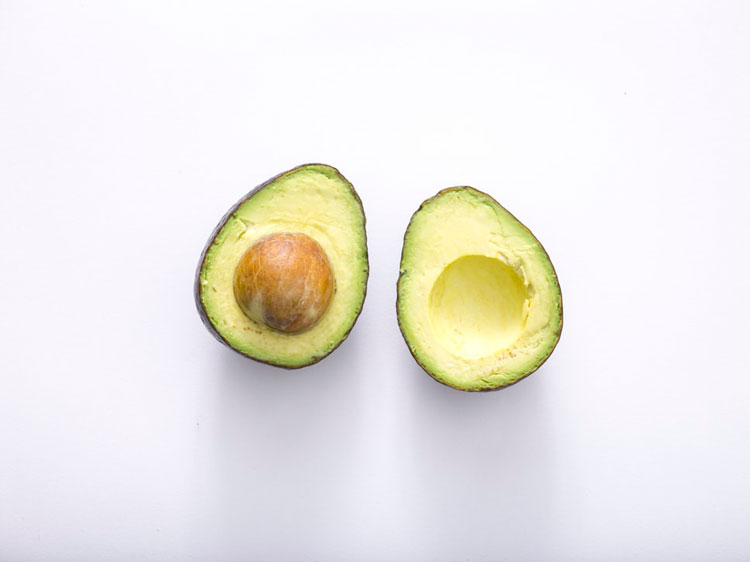 Sliced avocado with pit exposed