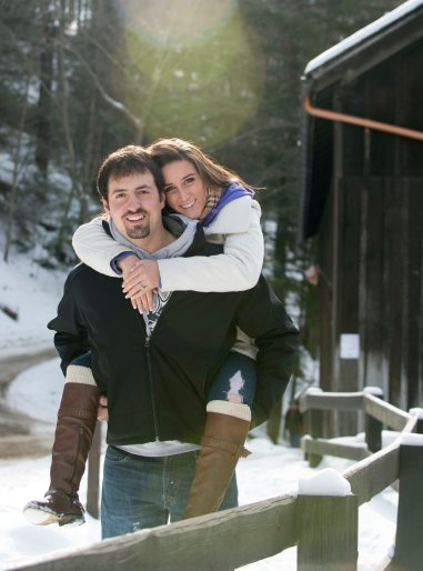 romantic winter engagement portrait poses carry girl on back