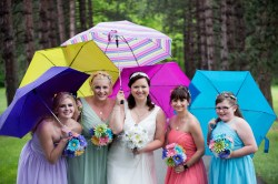 bridesmaids with different colored umbrellas