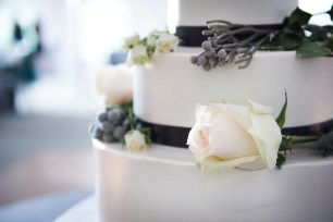 wedding cake details white roses and gray berries and ivy