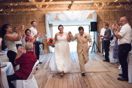 bride and groom entrance in barn at For All Families Farm wedding