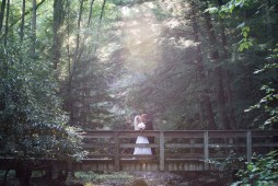romantic bride and groom pictures kissing on bridge on golf course at Chestnut Ridge