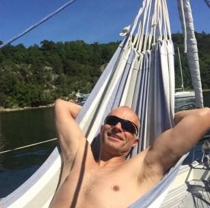 Captain enjoys sun in hammock
