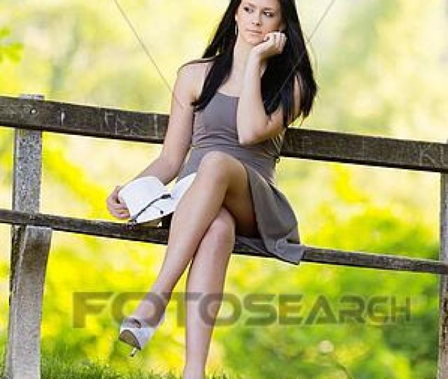 Picture Teen Girl In Park Crossed Legs Fotosearch Search Stock Photos Images