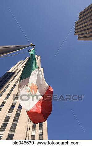 Stock Photograph of Low angle view of Mexican flag ...