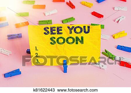 Handwriting text writing See You Soon. Concept meaning used for saying goodbye to someone and going to meet again soon Colored clothespin papers ...