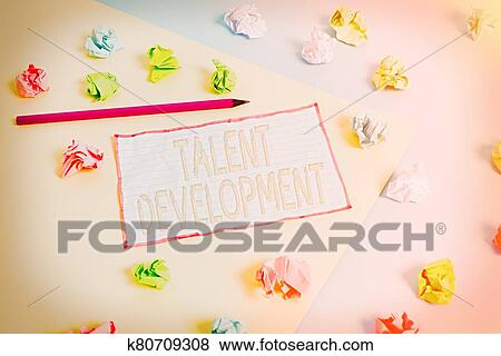 Conceptual hand writing showing Talent Development. Business photo text Building Skills Abilities Improving Potential Leader Colored crumpled ...