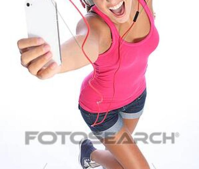 Stock Image Happy Sexy Teenage Girl Has Music Fun With Phone Fotosearch Search
