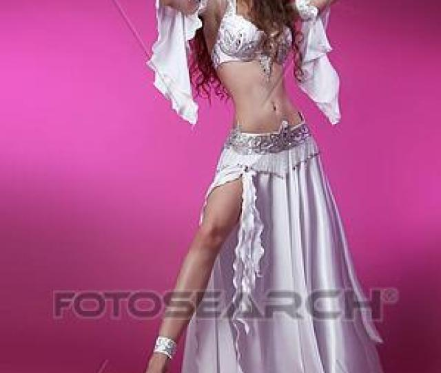 Sexy Arabian Oriental Professional Artist In Carnival Shining Costume With Long Curly Hair Exotic Star Of Belly Dance Dancing Girl Brunette