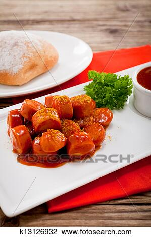 Curry wurst spicy sausage with curry and ketchup Stock Image | k13126932 | Fotosearch
