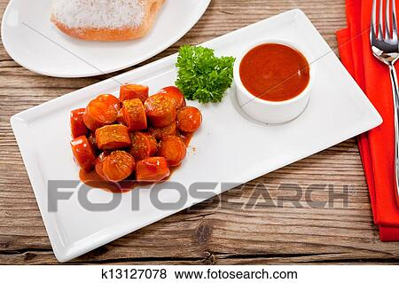 Curry wurst spicy sausage with curry and ketchup Stock Photo | k13127078 | Fotosearch