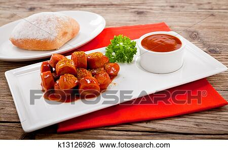 Curry wurst spicy sausage with curry and ketchup Stock Photograph | k13126926 | Fotosearch