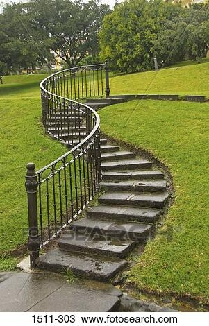 Winding Steps And A Wrought Iron Handrail On A Hillside Costa   Wrought Iron Handrail For Steps   3 Step   Grill   Forged Iron   Cast Iron   Wood Wall Mounted Stair