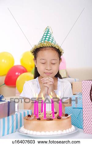 Stock Photo Of Girl Making Wish In Front Of Birthday Cake
