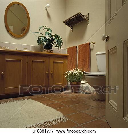 white rug on terracotta floor tiles in