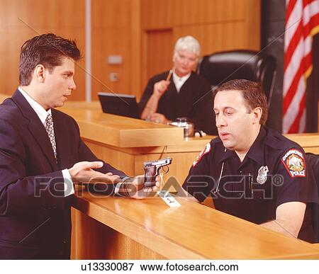 Picture of Attorney Questioning a Witness about Evidence ...