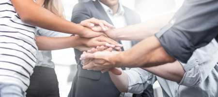 business people high five; team communication strategies