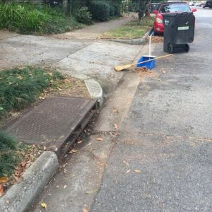 In this photo, Tommy Lewis shows the simple tools necessary to prevent flooding on your street.