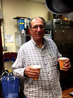 Ronnie Brink serving up coffee to the volunteers in the kitchen at Deutsches Haus.