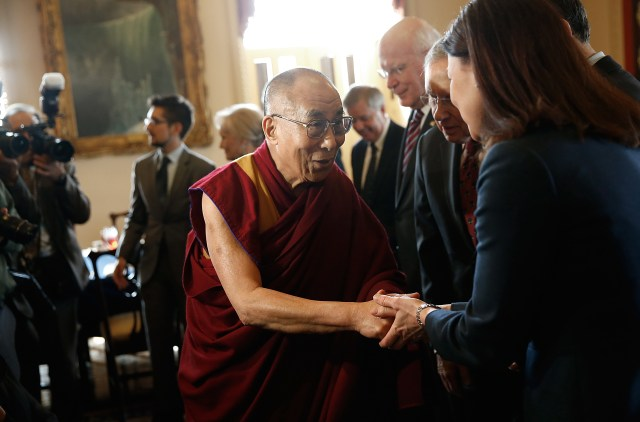 The Dalai Lama shaking hands with officials at Capitol Hill in 2014