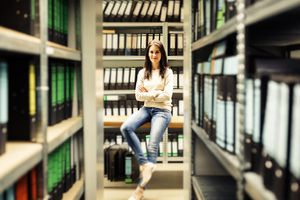 Woman sitting among archives