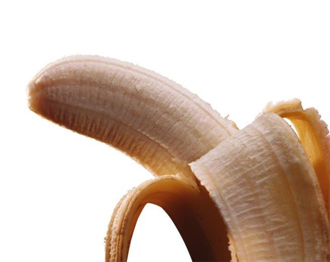 Photograph of a peeled banana.
